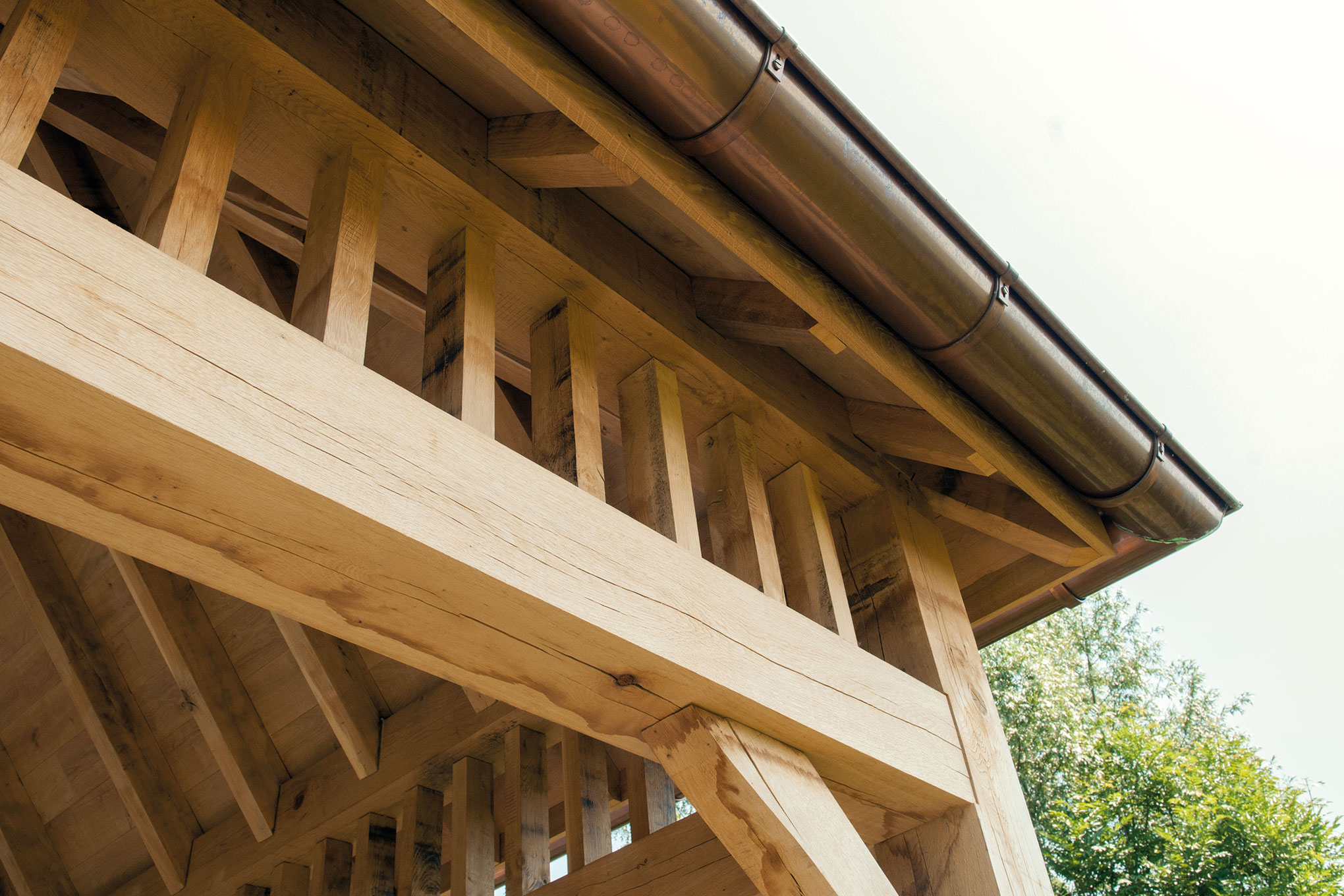 Classic oak patio cover in harmony with main house waasland