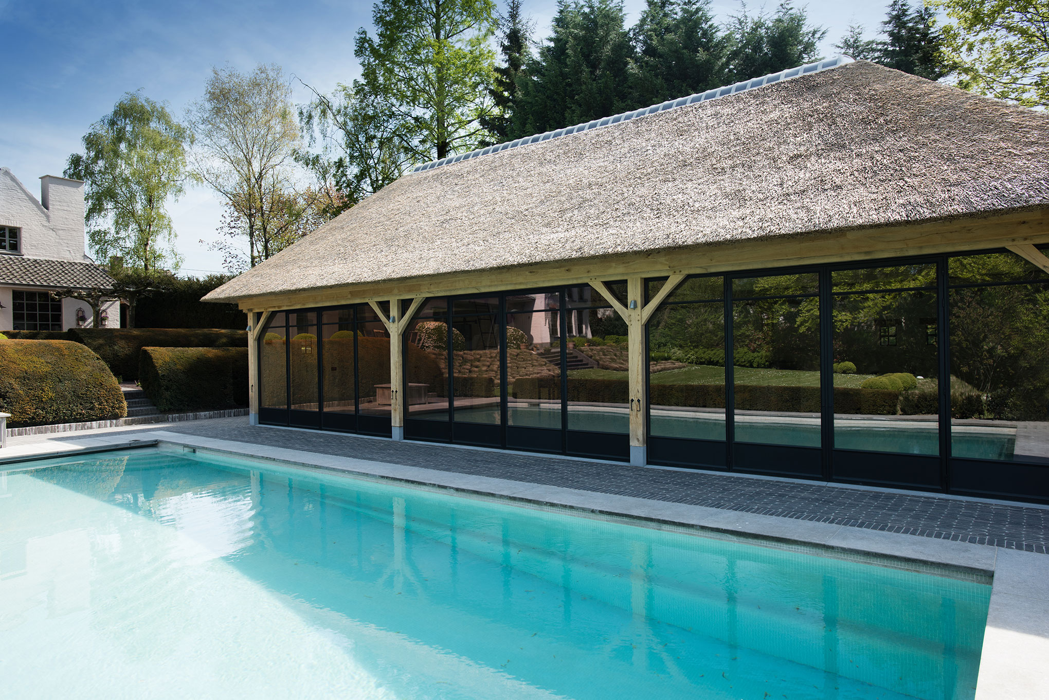 Exclusive two level pool house with thatched roof ronse livinlodge